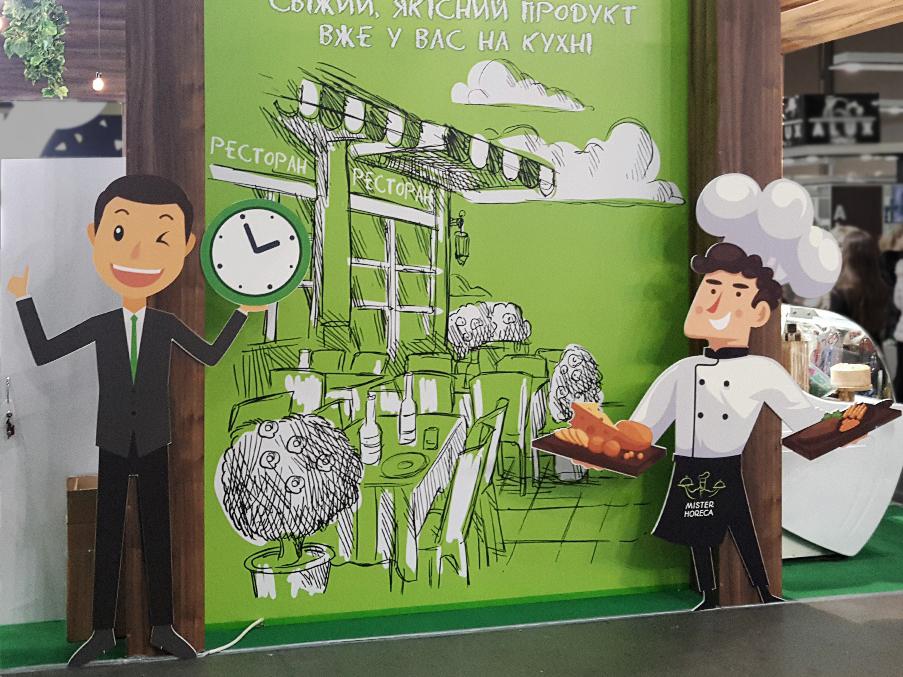 Картонні фігури на стенді на харчовій виставці