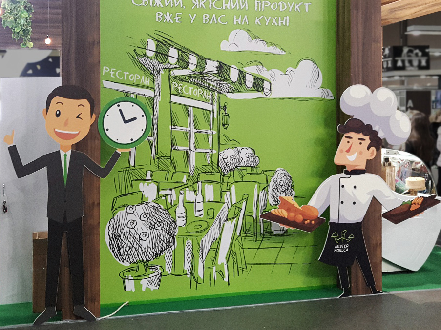 cardboard figures at the exhibition booth at food trade fair