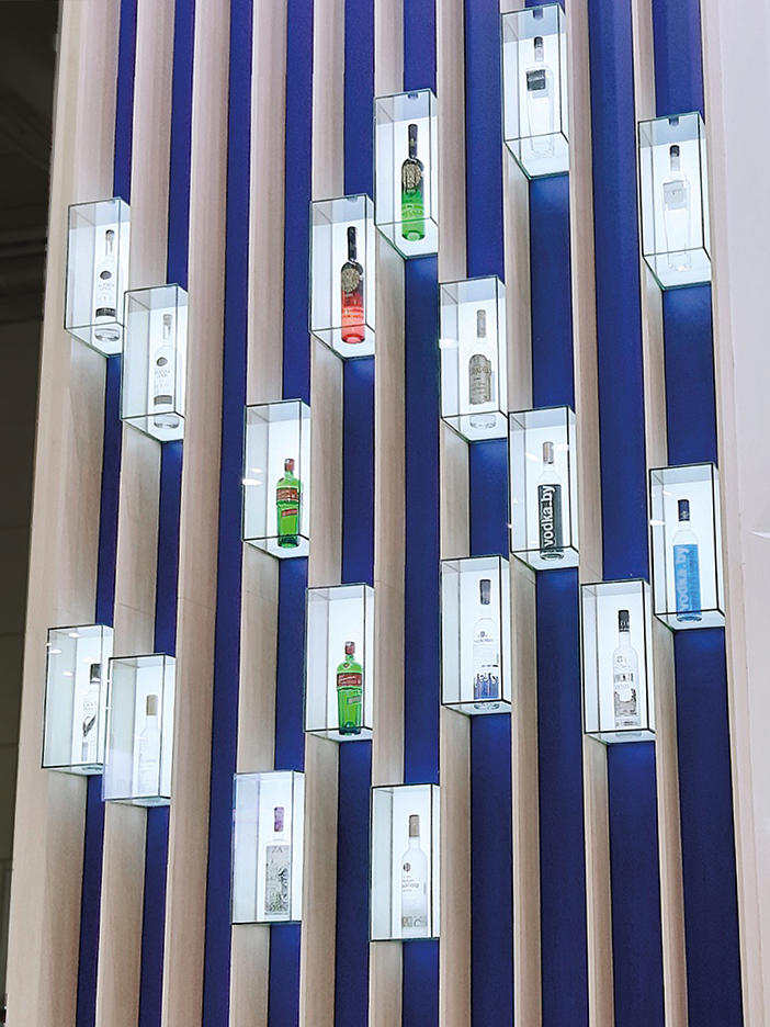 glass boxes with bottles of alcoholic drinks on the stand